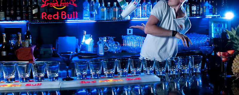 What are the benefits of employing flair bartenders?